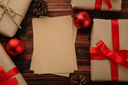 Christmas and new year with gift boxes and string light decoration on wooden table background top view with copy space. 版權商用圖片