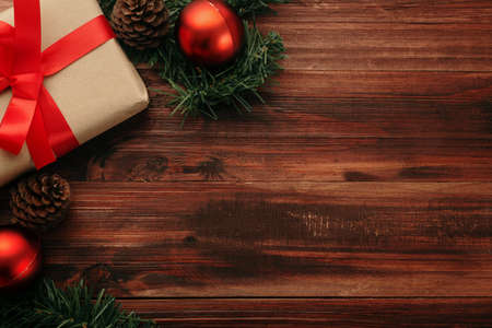 Christmas and new year with gift box wrapped with kraft brown paper and red ribbon on wooden table background top view. 版權商用圖片 - 158260744