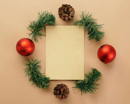 Christmas and new year with gift box wrapped with kraft brown paper and red ribbon on wooden table background top view. 版權商用圖片 - 158260752