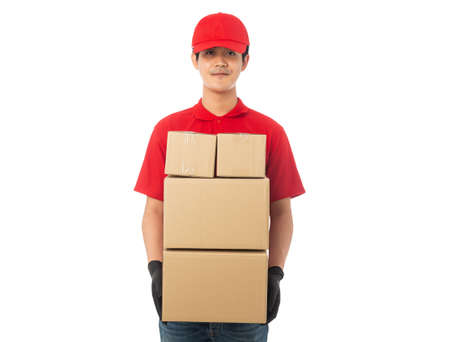 Young Delivery man in red uniform holding paper cardboard box mockup isolated on white background