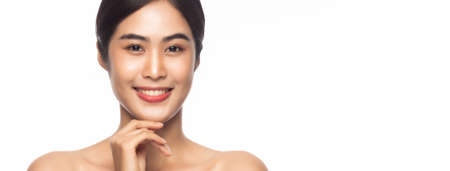 Beautiful Young Asian woman clean fresh skin with hands touching face isolated on white banner background. Facial treatment, Cosmetology, Beauty and skin care concept.
