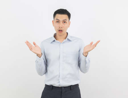 Young handsome business asian man making doubts gesture isolated on white background. 版權商用圖片
