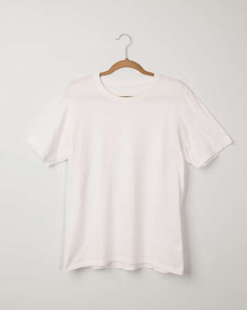 Blank White T-Shirts mockup hanging on white wall, Template for your design. Zdjęcie Seryjne