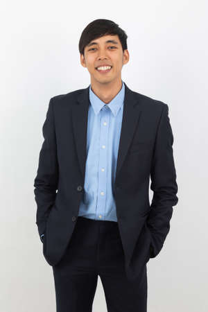 Portrait of happy smiling asian businessman in black suit isolated on white background, Business success concept.