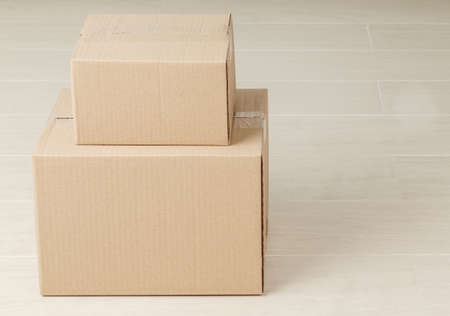 Stack of blank paper cardboard box mockup on the floor, Packaging template.