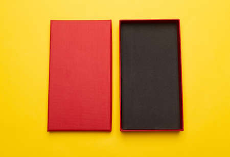 Red box product packaging isolated on yellow background. Flat lay Top view. 版權商用圖片
