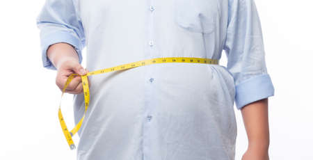 Fat man holding a measurement tape for check out his body isolated on white background.