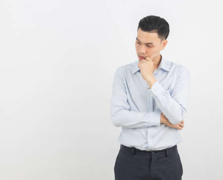 Young asian business man unhappy and frustrated with something. Negative facial expression isolated on white background.