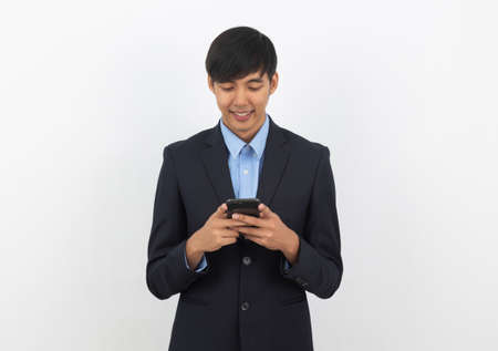 Young handsome asian business man using smartphone with smiling isolated on white background.