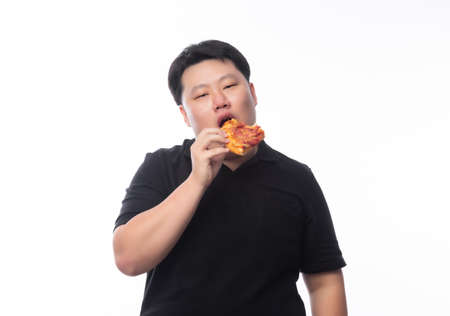 Young Funny Fat Asian man eating hawaiian pizza isolated on white background, Unhealthy concept.