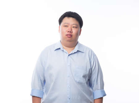 Asian fat man in blue shirt thinking and looking to copyspace isolated on white background.