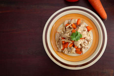 Roasted chicken with carrots and mushroom on wooden background, Healthy plate concept.