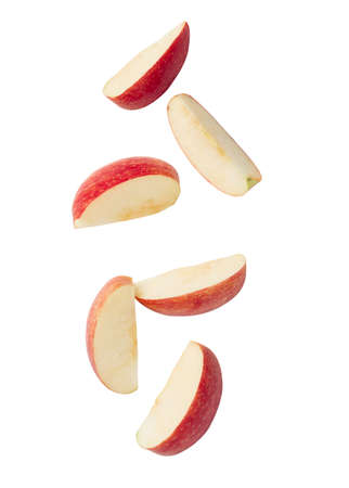 Falling red apple slice isolated on white background