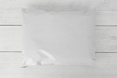 Blank white plastic bag packaging mockup on wooden background, Online shopping packaging, Packaging template. Zdjęcie Seryjne