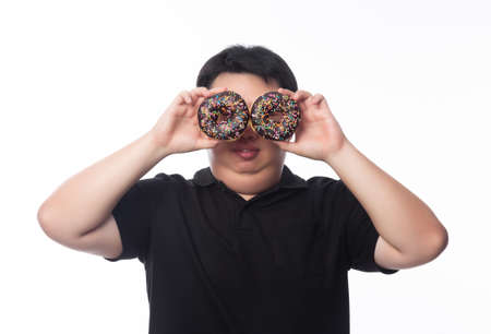 Young Funny Fat Asian man playing with chocolate donuts isolated on white background, Unhealthy concept.