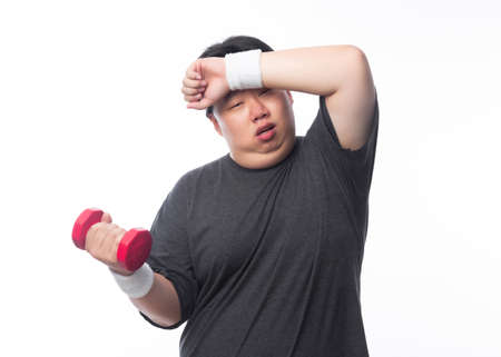 Young Asian funny fat sport man exercise with dumbbell isolated on white background. 版權商用圖片