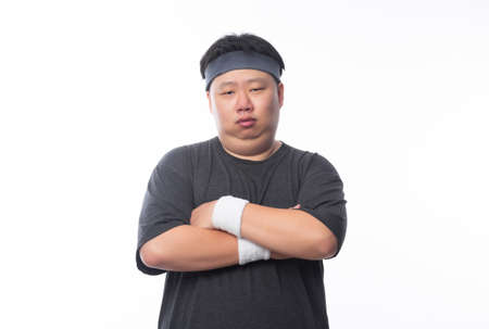 Portrait of Young Asian funny fat sport man isolated on white background.