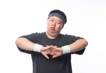 Young Asian funny fat sport man stretching before exercise isolated on white background. 版權商用圖片