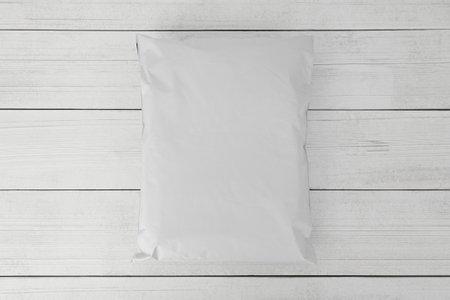 Blank white plastic bag packaging mockup on wooden background, Online shopping packaging, Packaging template. 版權商用圖片