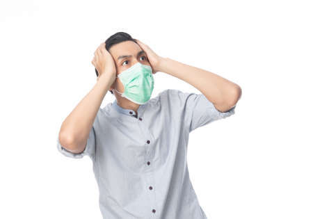 Young Asian businessman in hygienic mask shocking, 2019-nCoV or coronavirus. Airborne respiratory illness such as pm 2.5 fighting. Studio shot isolated on white background.