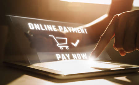 Online payment concept, Man using tablet computer and holding credit card at working desk. Banking and online shopping. 版權商用圖片