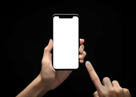 Male hands holding and using smartphone with blank screen at night, Overwork and late work concept