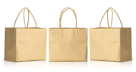 Recycled brown paper shopping bags isolated on white background