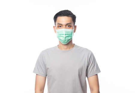 Young Asian Man wearing hygienic mask to prevent infection, 2019-nCoV or coronavirus. Airborne respiratory illness such as pm 2.5 fighting and flu. Studio shot isolated on white background.