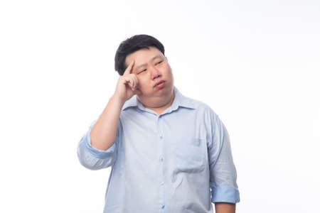 Young Fat Asian business man thinking with doubts face isolated on white background. 版權商用圖片