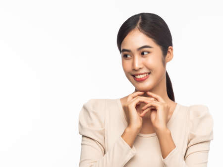 Portrait of young asian business woman smiling  isolated on white background.