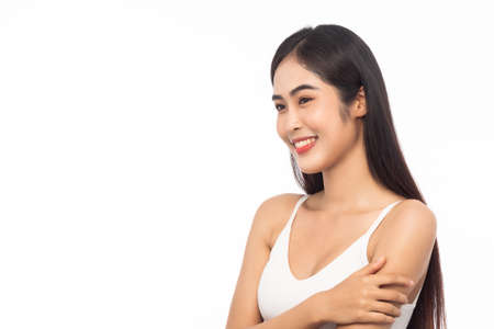 Beautiful Young Asian woman with clean fresh skin. Facial treatment, Cosmetology, Beauty and skin care concept. Girl beauty face isolated on white background.