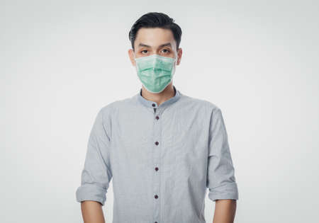 Young Asian Businessman wearing hygienic mask to prevent infection