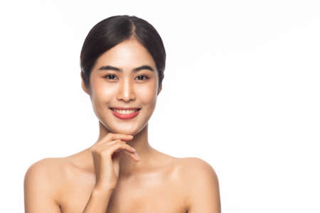 Beautiful Young Asian woman clean fresh skin with hands touching face isolated on white background. Facial treatment, Cosmetology, Beauty and skin care concept.