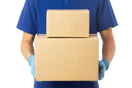 Closeup delivery man hand in medical gloves holding cardboard boxes isolated on white background, Packaging mockup, Delivery service concept.