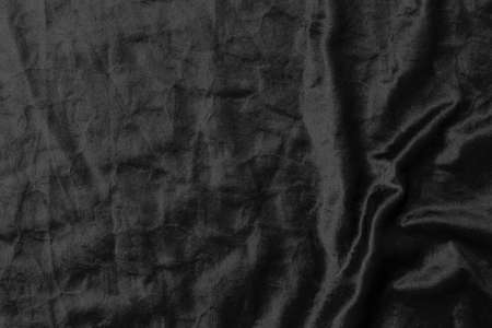 Abstract black fabric cloth texture background or liquid wave or wavy folds.