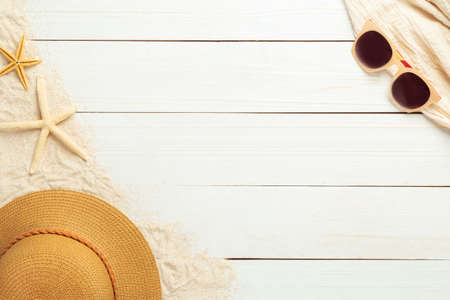 Summer background with beach accessories - straw hat, sunglasses on white wood table background top view with copy space. 版權商用圖片