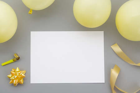 Happy birthday background, Flat lay party decoration with flyer invitation card on pastel grey background.