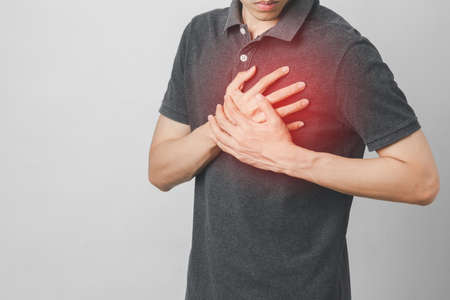 Man has chest pain suffering by heart disease, Cardiovascular disease, heart attack. Health care concept. Stock Photo