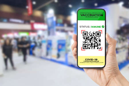 Vaccine digital passport on smartphone screen as proof that the holder has been vaccinated against Covid-19 at the exhibition hall, Requirement for exhibition.