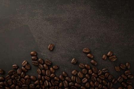 Coffee beans on grunge background. Фото со стока