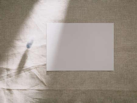 Invitation card mockup, blank greeting card template. Flat lay, Minimalist style. Фото со стока