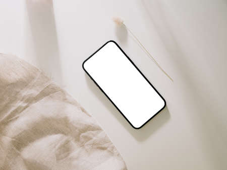 Smartphone mockup, Phone with blank screen template. Flat lay, Minimalist styled.