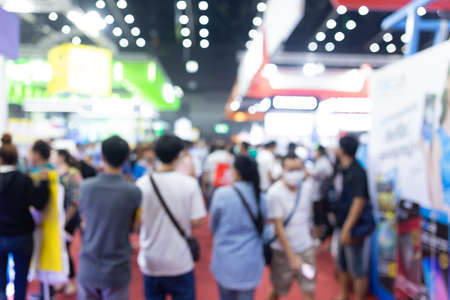 Abstract blur people in exhibition hall event trade show expo background. Business convention show, job fair, or stock market.