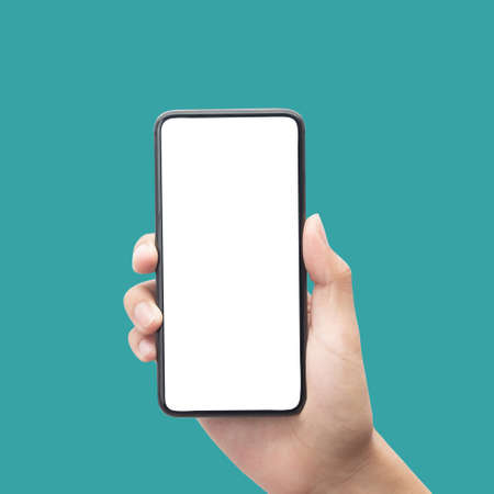 Man hand holding smartphone with blank screen isolated on blue background