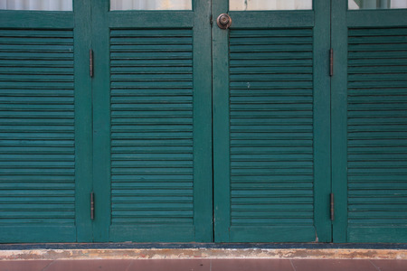 front stoop: wooden door of a home with green