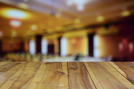 blurred image wood table and abstract Conference and Presentation. Audience at the conference hall