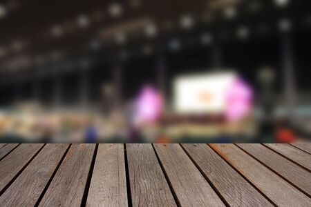 wood trade: blurred image wood table and abstract trade show area and people. Blurred image background Stock Photo