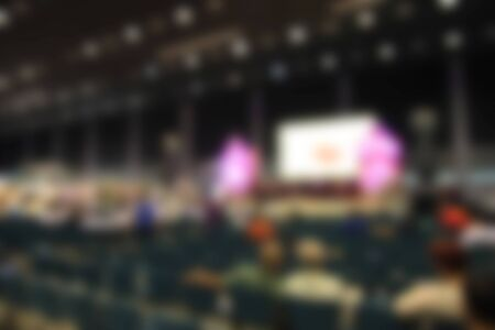 attendee: trade show area and people. Blurred image background