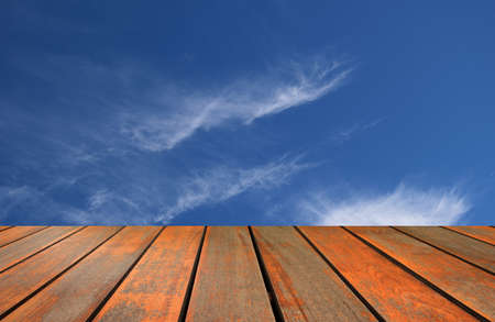 fleecy: blurred image wood table and abstract blue sky background Stock Photo