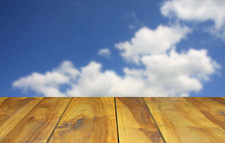 dispel: blurred image wood table and abstract blue sky background Stock Photo